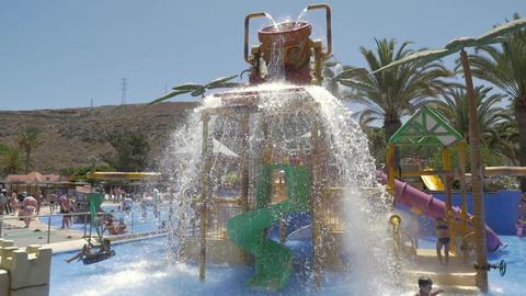 Children at water attraction on resort Footage
