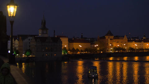 Evening cityscape with walking people on the picturesque Charles Bridge, Prague, Live Action