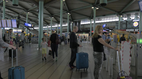 Traffic of passengers with luggage in Amsterdam Airport Footage