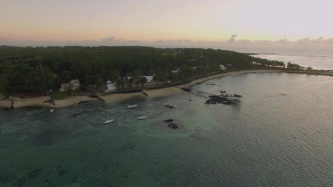 Aerial view of ocean blue water with waves, corals and water plants, camera movi Footage