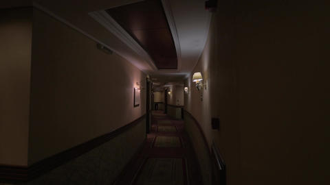 View of round hotel corridor with lighted lamps Live Action
