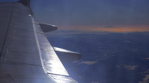 Aircraft wing and picturesque mountain landscape from high level from airplane w Footage