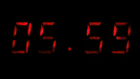 Digital clock shows time of 05 hours 59 minutes to 06 hours 00 minutes Footage