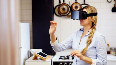 Woman using virtual reality headset in kitchen Live Action