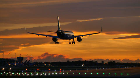 Commercial Aircraft Landing at Barcelona Airport at Sunset Footage