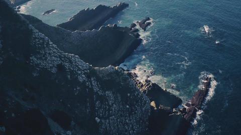 Flight Above Sharp Cliff in Ocean Live Action