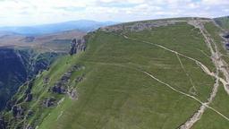 Caraiman Peak, flight from Heroes Cross to hikers on mountain trail, Romania Footage