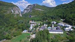 Polovragi Monastery, Romania, aerial flight, tilt Footage