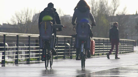 Parents riding bicycles with their children along embankment, enjoying weekend Footage