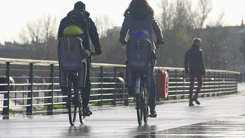Parents riding bikes with their kids, family values, happy weekend. Slow motion Footage