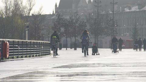 Parents walking with children along embankment, enjoying weekend in city center Footage