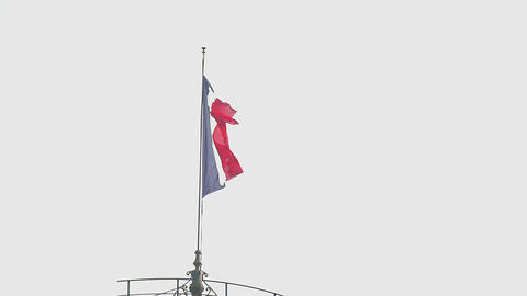 French tricolor flag waving in the wind above the city, patriotism, freedom Footage