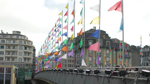 People walking bridge decorated with many colorful banners, festive atmosphere Footage