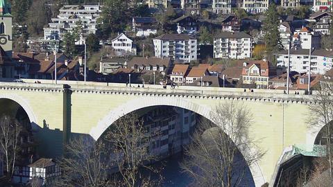 Old stone arch bridge Untertorbrucke spanning Aare river in Bern, Switzerland Footage