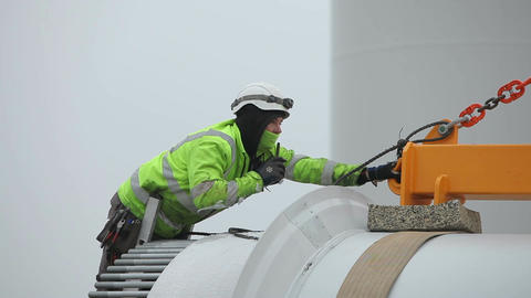 Young Worker in Green Jacket Bowing Above the Blade Footage