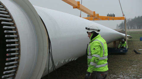 Worker Pressing Tape to The Rotor Blade Footage