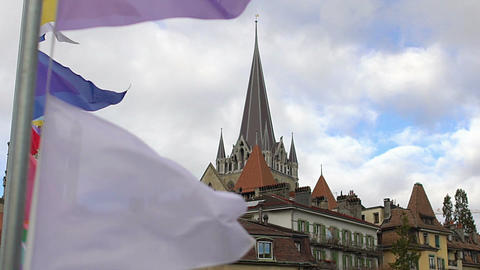 Colorful banners waving in wind, nice view of Lausanne Notre Dame Cathedral Footage