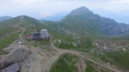 Aerial view of the Omu peak and chalet, Bucegi mountains, Romania Footage