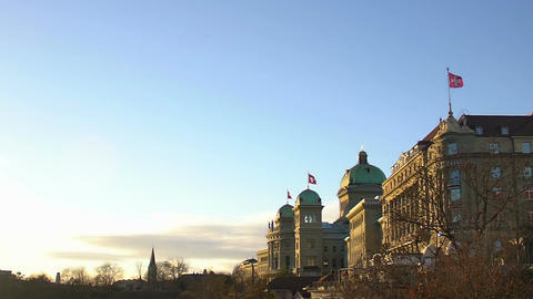 Swiss flags waving on parliament building in Bern, Switzerland, slow motion Footage