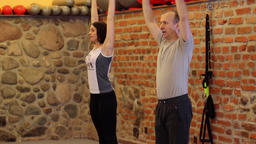 Fitness training with personal trainer at fitness center Live Action