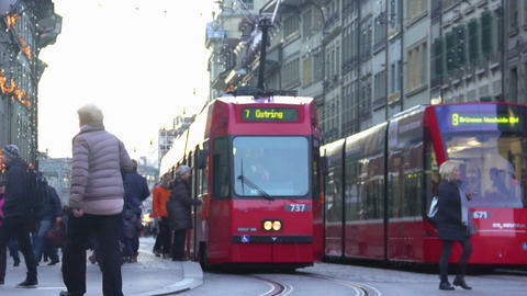 Weekend in downtown, people using modern tram network to travel around city Footage
