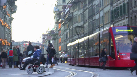 Disabled person in modern wheelchair crossing street, tolerant equal society Footage