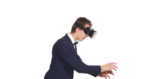 Handsome man wearing future technology virtual reality glasses Footage
