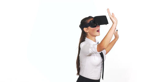 Woman wearing virtual reality glasses and making gestures Footage