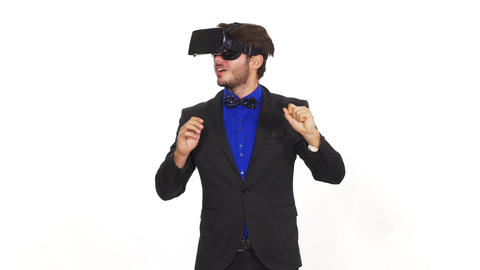 Amazed young man wearing virtual reality glasses Footage