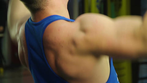 Young man building muscles, doing pulldown exercise, intensive workout in gym Footage