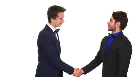 Business partners handshaking while becoming tense Live Action
