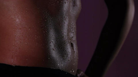 Sportive lady's flat tummy covered with sweat drops after active workout in gym Live Action
