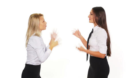 Two female colleagues talking when a male colleague with a smart phone passes by Footage