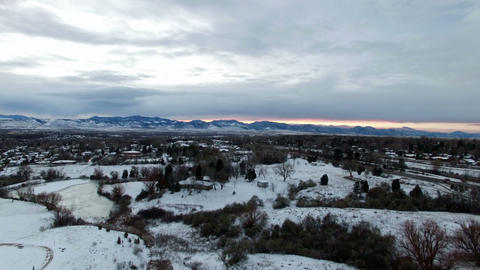 Aerial drone lift up winter snowy park to mountain range sunset ビデオ