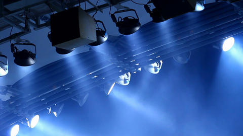 Expensive light equipment hanging above stage in a concert hall, performance Footage