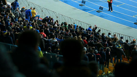 Male football fans jumping on tribunes and chanting slogans, active supporters Footage