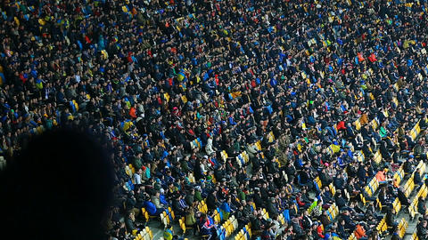 Millions of football fans sitting on tribunes and watching match, sporting event Footage