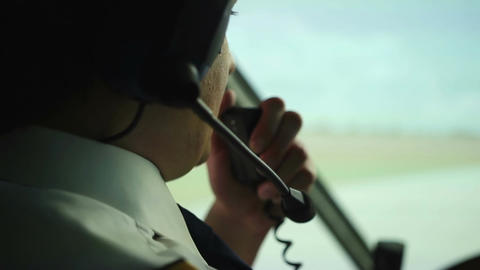 Civil aviation pilot using radio for communication with air traffic controller Live Action