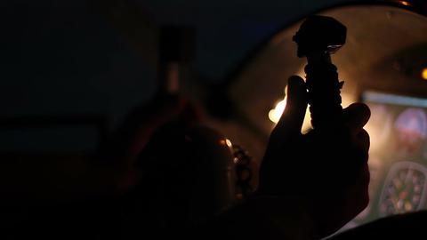 Hands of pilot navigating aircraft, night sky seen through glass, cockpit panel Footage