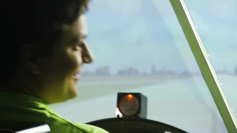 Private pilot sitting in cockpit showing thumbs up, flight simulator, cool hobby Footage