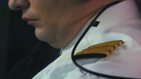 Serious pilot concentrating on flight, responsibility, commitment, high paid job Live Action