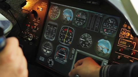Hand of teacher showing student cockpit panel inside flight simulator, aviation Footage