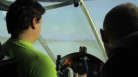 Teacher and beginner student training on flight simulator at aviation school Footage