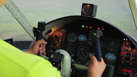 Happy young man enjoying leisure in flight simulator, pilot training skills Footage