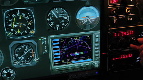 Flight control panel showing altitude and speed details, pilot switching radio Footage