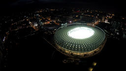 Bird's eye view of illuminated stadium with green soccer field ready for match Footage