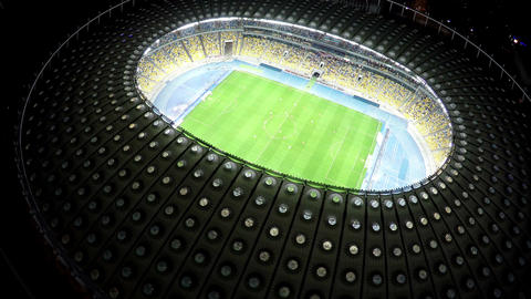 Large football stadium with creative design, night cityscape, view from above Footage