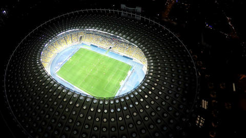 Bird's eye view on big soccer stadium with players, exciting football game Footage