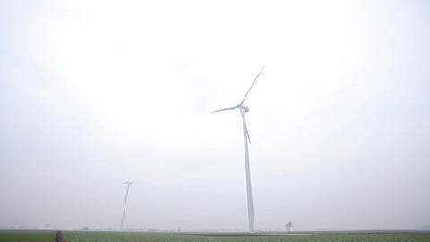 Two Wind Turbines Working. Long shot Footage
