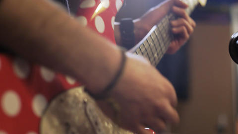 Hands of a Man Playing Red and White Electric Guitar Footage